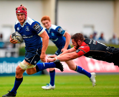 Leinster's Josh van der Flier evades a tackle from James Thomas