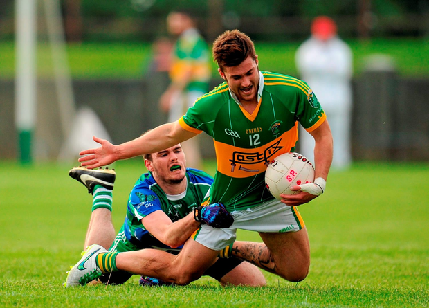 Ben McLaughlin, Sean O'Mahony's, is fouled by Patrick Kirk, St Patrick's, who was subsequently showed a black card