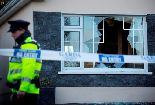 A garda on duty at the scene of the break-in at the home of the Corcoran family in Co Tipperary during which seven men terrorised the family. The gang was sentenced to a total of 105 years in jail last week. Photo: Mark Condren