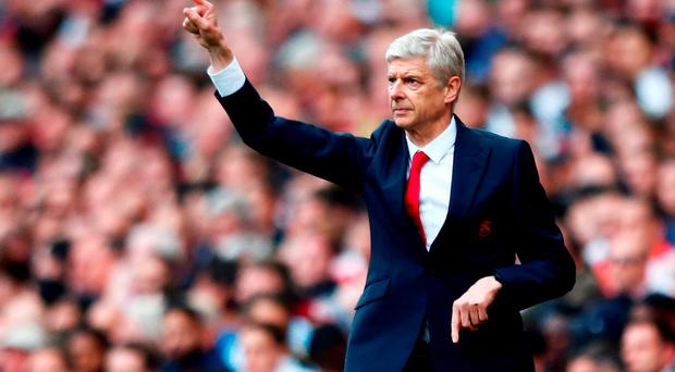 Arsene Wenger signals to his players during yesterday's win over Manchester United