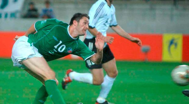 Robbie Keane strikes late to draw Ireland level during the 2002 World Cup against Germany