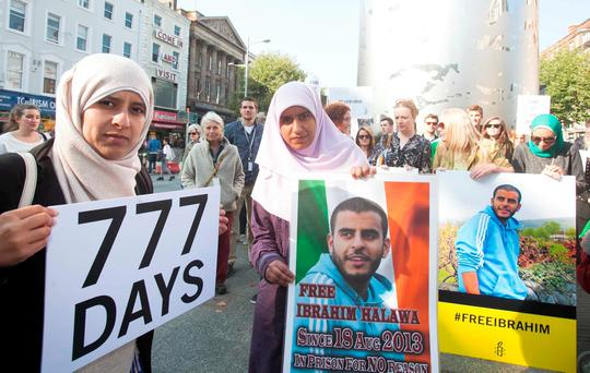 Sisters Somaia and Omaima Halawa at the 'Free Ibrahim Day' event at the Spire on Connell Street, Dublin, last week on the 777th day of their brother Ibrahim's incarceration in an Egyptian jail. Photo: Leah Farrell