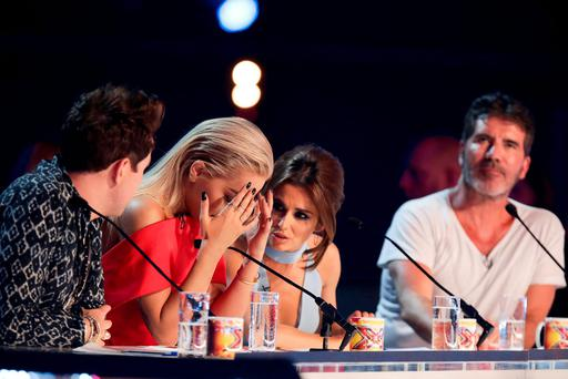 MANDATORY CREDIT REQUIRED: SYCO/THAMES TV Undated handout photo issued by ITV of judges (left-right) Nick Grimshaw, Rita Ora, Cheryl Fernandez-Versini and Simon Cowell during the Six Chair Challenge during the ITV1 talent show, The X Factor. PRESS ASSOCIATION Photo. Issue date: Sunday October 4, 2015. See PA story SHOWBIZ XFactor. Photo credit should read: SYCO/THAMES TV/Corbis/Dymond/PA Wire NOTE TO EDITORS: This handout photo may only be used in for editorial reporting purposes for the contemporaneous illustration of events, things or the people in the image or facts mentioned in the caption. Reuse of the picture may require further permission from the copyright holder.