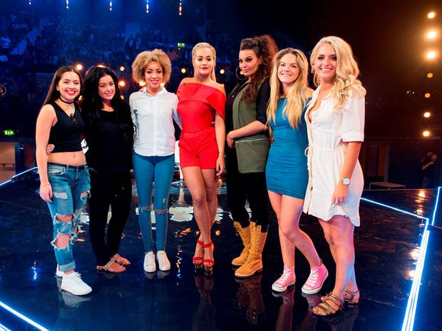 Undated handout photo issued by ITV of (left-right) Havva Rebke, Lauren Murray, Kiera Weathers, Rita Ora, Monica Michaels, Louisa Johnson and Chloe Paige during the Six Chair Challenge during the ITV1 talent show, The X Factor. SYCO/THAMES TV/Corbis/Dymond/PA Wire