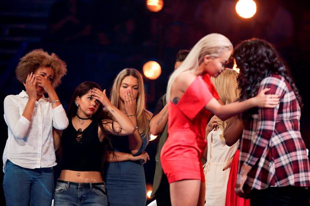 Embargoed to 2101 Sunday October 4 MANDATORY CREDIT REQUIRED: SYCO/THAMES TV Undated handout photo issued by ITV of Rita consoling Karen Mav after the Six Chair Challenge during the ITV1 talent show, The X Factor. PRESS ASSOCIATION Photo. Issue date: Sunday October 4, 2015. See PA story SHOWBIZ XFactor Results. Photo credit should read: SYCO/THAMES TV/Corbis/Dymond/PA Wire NOTE TO EDITORS: This handout photo may only be used in for editorial reporting purposes for the contemporaneous illustration of events, things or the people in the image or facts mentioned in the caption. Reuse of the picture may require further permission from the copyright holder.