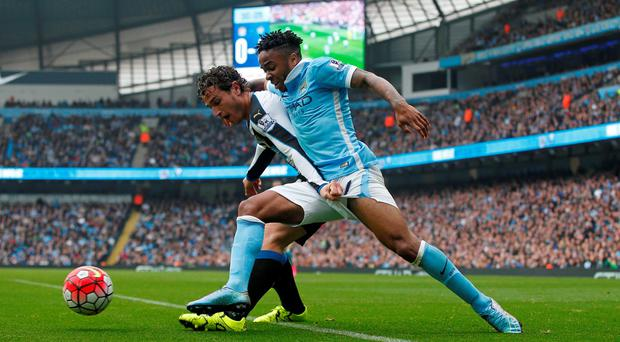 Manchester City's Raheem Sterling in action with Newcastle's Daryl Janmaat