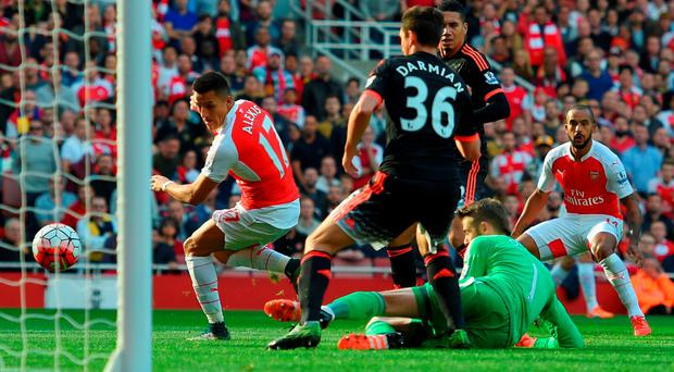 Alexis Sanchez puts Arsenal ahead against Manchester United with a deft flick of his right boot at the Emirates GETTY