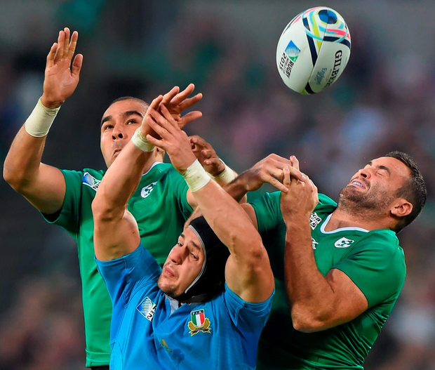 Simon Zebo, left, and Dave Kearney jump for the ball with Italy's Michele Campagnaro during yesterday's World Cup game at the Olympic Stadium, London Photo: Stephen McCarthy / SPORTSFILE