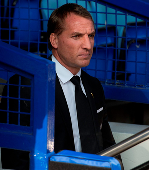 Brendan Rodgers sits in the dug-out at Goodison Park yesterday in what proved to be his final match in charge of Liverpool