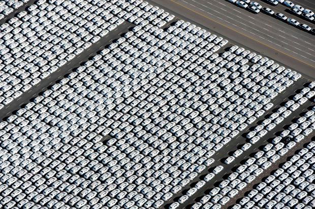 "New VW cars stand ready for shipping next to the Volkswagen plant in Emden, northwestern Germany, as chairman Hans Dieter Poetsch described the situation at the firm as an ""existence-threatening crisis"". Photo: AFP"
