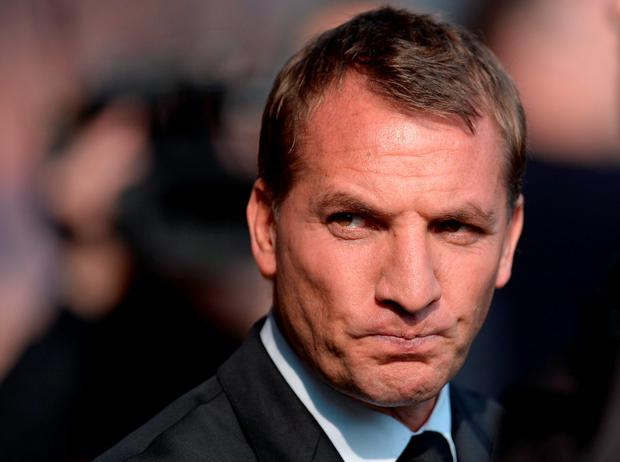 Liverpool's Northern Irish manager Brendan Rodgers ahead of the English Premier League football match between Everton and Liverpool at Goodison Park in Liverpool north west England on October 4, 2015. AFP PHOTO / OLI SCARFF RESTRICTED TO EDITORIAL USE. No use with unauthorized audio, video, data, fixture lists, club/league logos or 'live' services. Online in-match use limited to 75 images, no video emulation. No use in betting, games or single club/league/player publications.OLI SCARFF/AFP/Getty Images