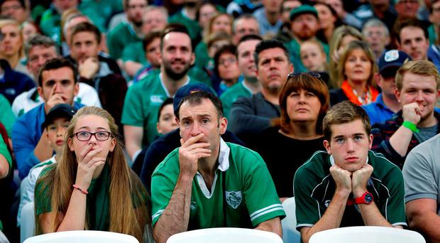 Nervous Irish fans during the match against Italy yesterday. Photo: Reuters