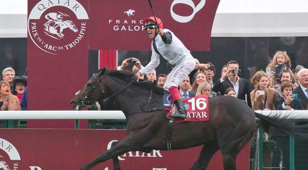 Italian Frankie Dettori riding Golden Horn reacts after crossing the finish line to win the Qatar Prix de l'Arc de Triomphe horse race at the Longchamp horse racetrack