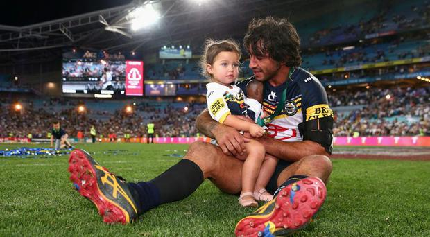 Johnathan Thurston and his daughter celebrate the win. Getty Images