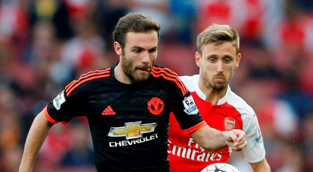 Manchester United's Juan Mata in action with Arsenal's Nacho Monreal