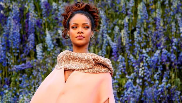 Singer Rihanna poses before attending the Spring/Summer 2016 women's ready-to-wear collection show for Dior fashion house during the Fashion Week in Paris