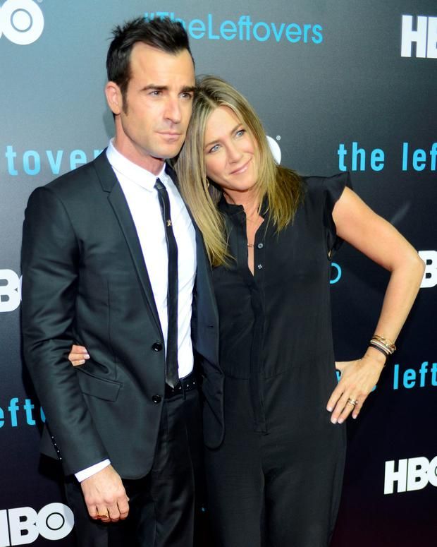 Justin Theroux (L) and Jennifer Aniston attend HBO's