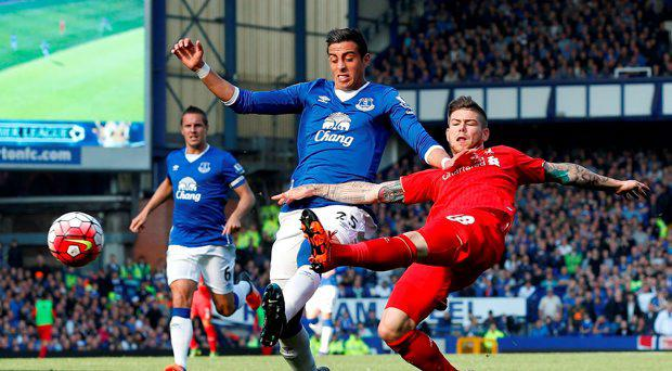 Liverpool's Alberto Moreno in action with Everton's Ramiro Funes Mori