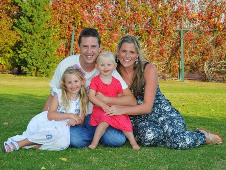 Handout image from Merseyside Police of PC Dave Phillips with his family.