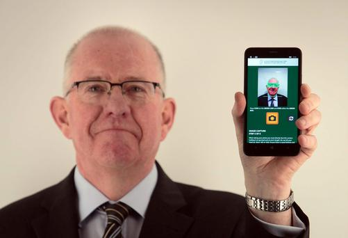 Minister for Foreign Affairs and Trade Charlie Flanagan, TD during the launch of the new Passport Card at the Passport Office,Dublin. Photo: Gareth Chaney Collins