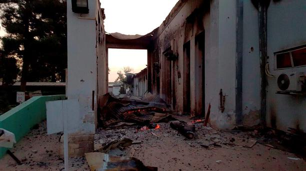 Fires burn in part of the MSF hospital in the Afghan city of Kunduz after it was hit by an air strike Credit: MSF