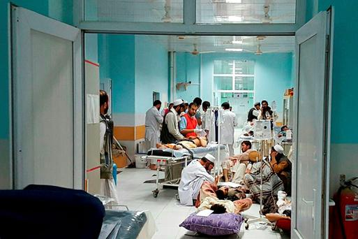 In this undated photograph released by Medecins Sans Frontieres (MSF) on October 3, 2015, Afghan MSF medical personnel treat civilians injured following an offensive against Taliban militants by Afghan and coalition forces at the MSF hospital in Kunduz. An air strike on the hospital in the Afghan city of Kunduz on October 3 left three Doctors Without Borders staff dead and dozens more unaccounted for, the medical charity said, with NATO conceding US forces may have been behind the bombing. The MSF facility is seen as a key medical lifeline in the region and has been running