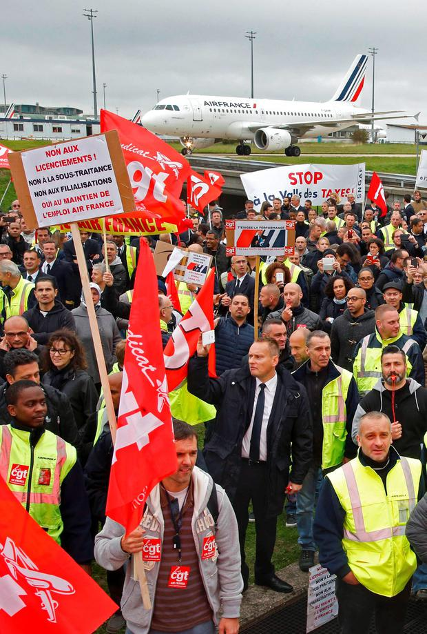Striking employees of Air France demonstrate in front of the Air France headquarters building at the Charles de Gaulle International Airport in Roissy, near Paris Credit: REUTERS/Jacky Naegelen