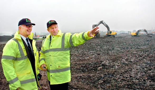 Taoiseach Enda Kenny with Mayo Renewable Power chairman Gerald Crotty after laying the foundation stone for the new biomass power station on the former Asahi site in Killala, Co Clare. Photo: Henry Wills
