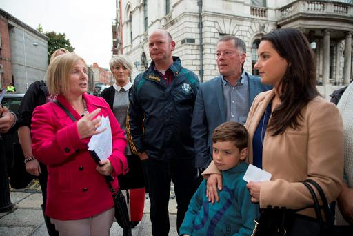Dublin Lord Mayor Críona Ní Dhálaigh speaks to Longboat Quay residents Jennifer Gleeson and her 8-year-old son Joshua before a council meeting at City hall in Dublin. Photo: Arthur Carronand