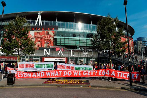 Fans protest at ticket prices at the Emirates ahead of the Barclays Premier League match between Arsenal and Manchester United