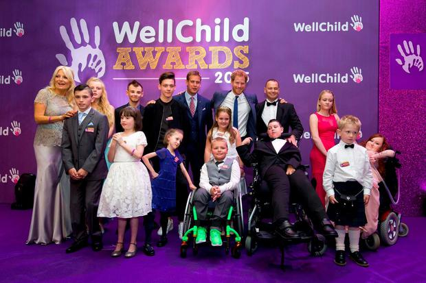 Prince Harry poses on stage with award recipients at the WellChild Awards in London which recognises the courage of seriously ill children, their families and carers Credit: Justin Tallis/PA Wire