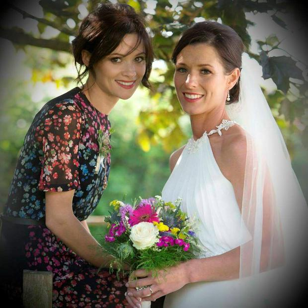 Cathriona White (left) and her sister Lisa posing for pictures on Lisa's wedding day in August 2014.