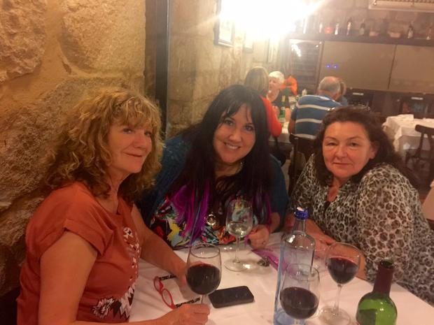 Cepta, Andrea and Mags pictured with a much-needed glass of wine