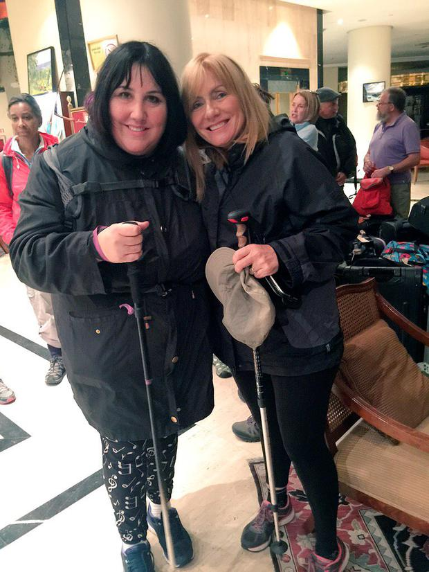 Andrea Smith and Frances Black show off their much-needed rain gear