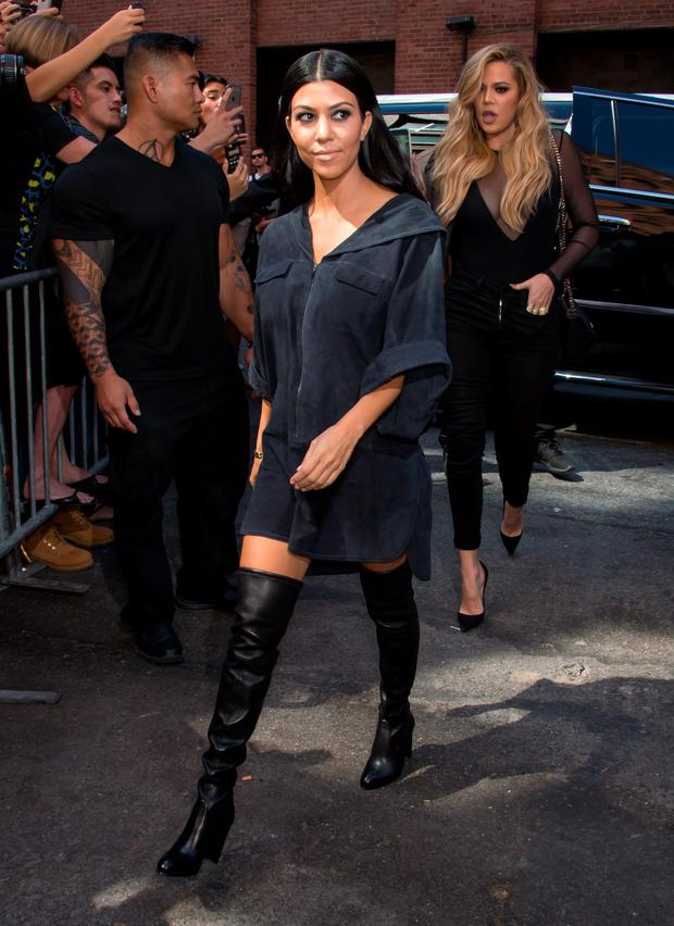 Kourtney Kardashian and Khloe Kardashian are seen arriving at Kanye West Yeezy Season 2 during Spring 2016 New York Fashion Week at Skylight Modern on September 16, 2015 in New York City. (Photo by Gilbert Carrasquillo/FilmMagic)