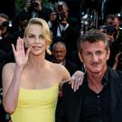 "Actors Sean Penn and Charlize Theron attend the premiere of ""Mad Max: Fury Road"" during the 68th annual Cannes Film Festival on May 14, 2015 in Cannes, France. (Photo by Clemens Bilan/Getty Images)"