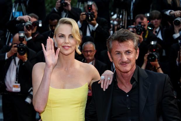 Actors Sean Penn and Charlize Theron attend the premiere of