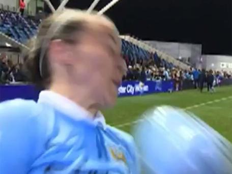Natasha Harding of Man City is hit by a stray ball duringa post match interview Credit : Getty Images