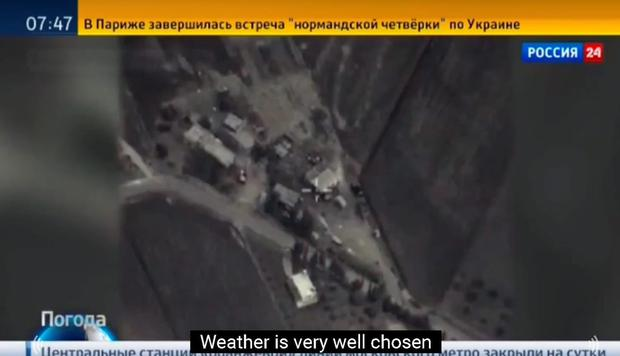 The weather report aired photos of Russian airstrikes, saying the weather was