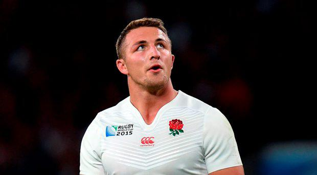 England have dropped Sam Burgess from their matchday 23 and named Henry Slade at outside centre for Saturday's final pool match against Uruguay in Manchester