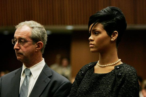 Lawyer Donald Etra (L) stands with singer Rihanna inside the Los Angeles Superior Court during the hearing in the Chris Brown felony assault case on June 22, 2009