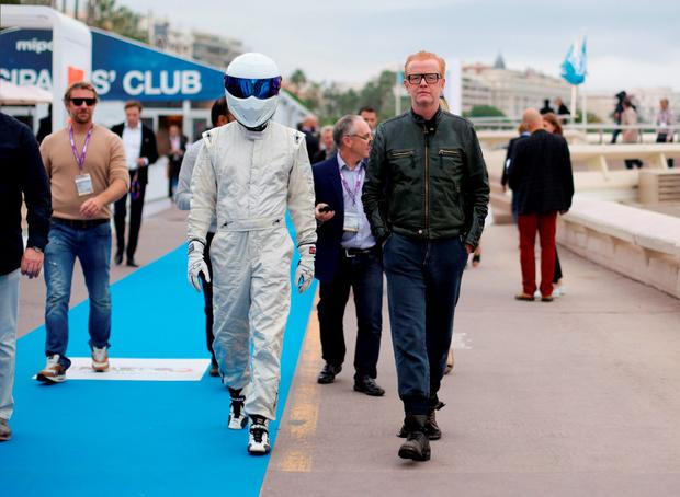 Chris Evans, the new presenter of BBC's Top Gear programme, and The Stig during a photocall on the Boulevard de la Croisette for the annual television industry trade show MIPCOM in Cannes, France. Yui Mok/PA Wire