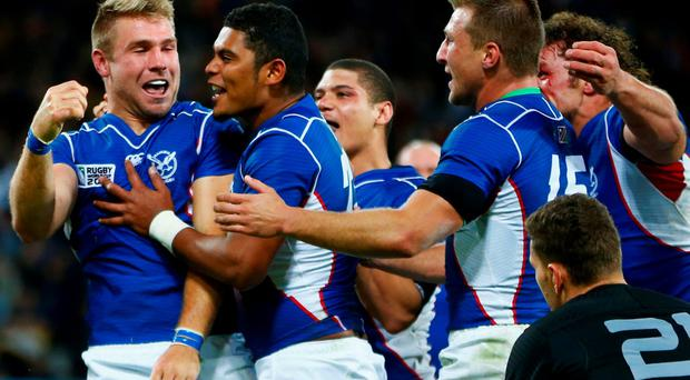 Johan Deysel (left) of Namibia celebrates his try against New Zealand in their World Cup pool clash