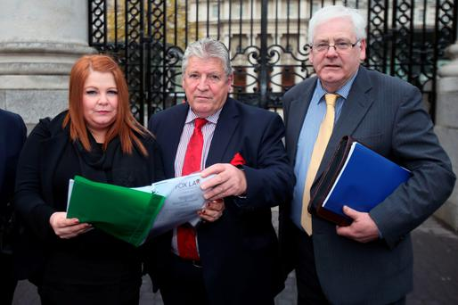 (left to right) Cat Wilkinson, Stanley McCombe and Michael Gallagher, representatives of families of the Omagh bomb victims, arrive at Government Buildings in Dublin to meet the Taoiseach Enda Kenny for the first time Credit: Niall Carson/PA Wire