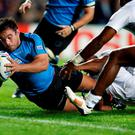 Hooker Carlos Arboleya crosses for Uruguay's first World Cup try since 2003