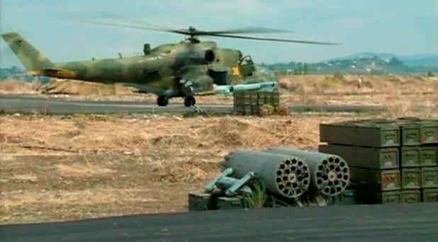 A still image taken from a October 6, 2015 footage shows a Russian air force helicopter on the tarmac of Heymim air base near the Syrian port town of Latakia. Photo: Reuters
