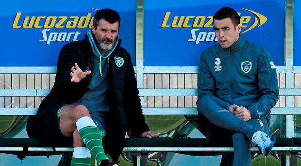 Republic of Ireland assistant manager Roy Keane wiith Seamus Coleman during squad training