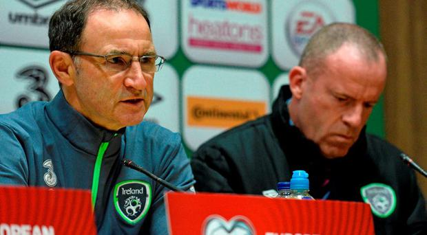 Republic of Ireland manager Martin O'Neill and Ian Mallon, FAI Director of Communications, during a press conference. Republic of Ireland Press Conference, FAI National Training Centre, National Sports Campus, Abbotstown, Dublin. Picture credit: David Maher / SPORTSFILE