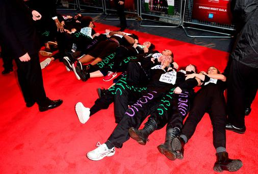 Protesters lie on the red carpet during the Suffragette Premiere held during the 59th BFI London Film Festival at Odeon Cinema at Leicester Square, London Credit: Ian West/PA Wire
