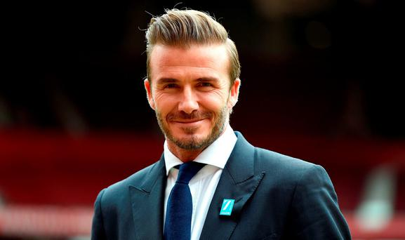 David Beckham stands on the Old Trafford pitch, to launch the upcoming UNICEF Match for Children, during a photocall at Old Trafford, Manchester.